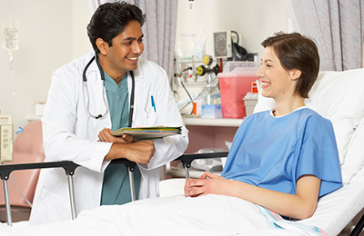 doctor and patient smiling while having a conversation