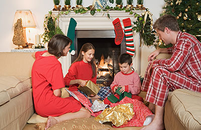 young family opening Christmas gifts