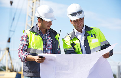 two engineers looking over project plans